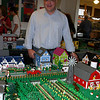 "Bill Probert stands within ""The Connecticut and Vermont Lego Railway,"" an operating model train layout made entirely of Legos on view at Danbury Railway Museum until June 27. Mr Probert worked with  Elroy Davis and Steve Doerner to create the train layour. All three are members of the New England Lego Users Group (NELUG).  (Hicks photo)"