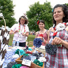 Raising money from sales at their booth during the Great Pootatuck Duck Race are Relay For Life Honorary Chair Jill Collins, left, and Jesicha Napolitano, right, with her daughter Megan Napolitano.  (Bobowick photo)