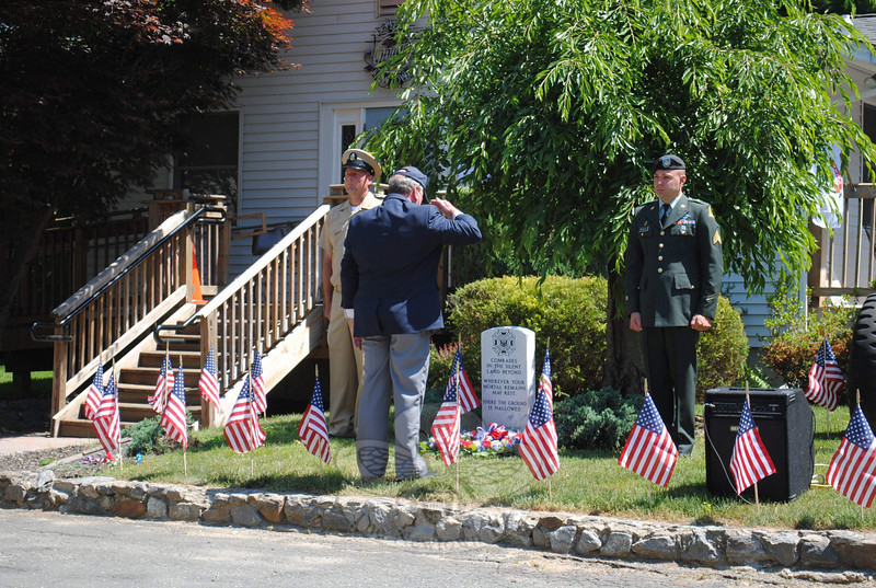 Senior Vice Commander of VFW Post 308 Bill Farley salutes after laying a wreath at the memorial headstone outside of the Tinkerfield Road VFW hall.  (Crevier photo)