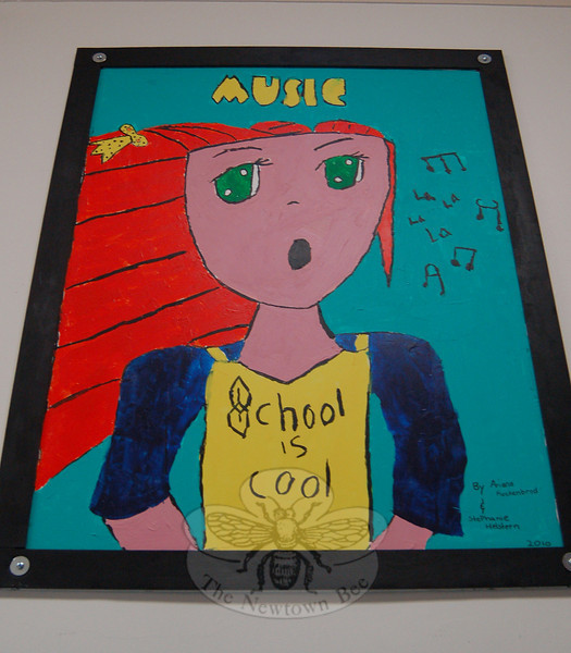 New artwork decorates the hallway outside of Hawley Elementary School's multipurpose room thanks to the work of 25 fourth grade students, who spent their lunch and recess creating 12 posters. Music's poster was created by Ariana Kuchenbrod and Stephanie Helstern. (Hallabeck photo)