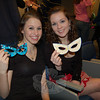 King cakes and masks waited for Newtown High School French students in the school's Lecture Hall on Wednesday, February 24. French 3 students Shayne Hindes and Emily Molloy, both sophomores, hold their masks for the day's celebration of Mardi Gras, typically celebrated the day before Ash Wednesday. The event was rescheduled for Wednesday due to winter weather. The king cakes were prepared by students, and each of the traditional desserts had a figurine hidden inside.  (Hallabeck photo)