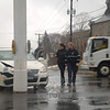 A one-car collision occurred at the hazardous flagpole intersection on Main Street during wet conditions about 12:44 pm on February 25. Police said motorist Noel Altan, 22, of Trumbull was driving a 2006 Volkswagen Jetta sedan westward on Church Hill Road and then attempted to turn left onto southbound South Main Street, but in doing so the sedan's front end squarely collided with the Main Street flagpole, damaging the auto. Newtown Volunteer Ambulance Corps members treated Altan at the scene for minor injuries. Altan was given a written warning for making a restricted turn.  (Hicks photo)