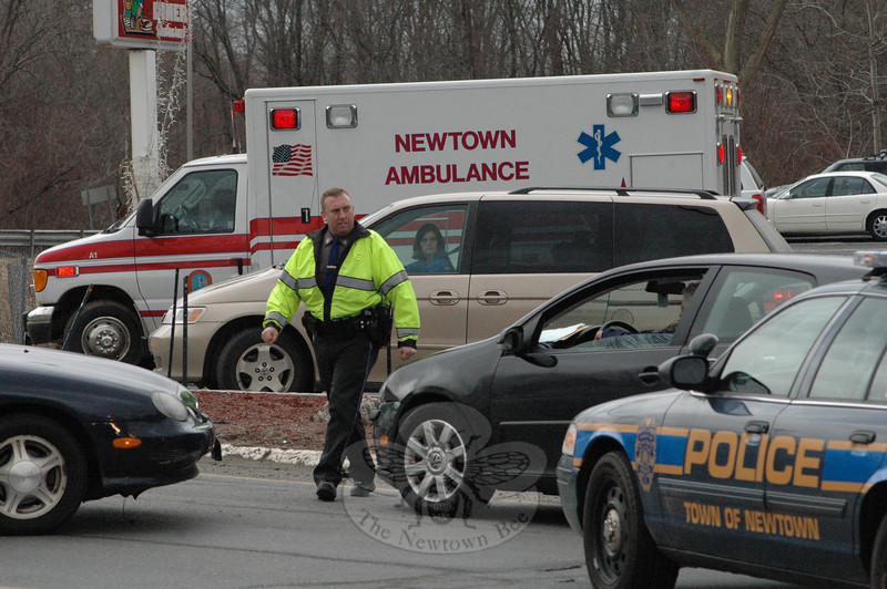 Police, Newtown Hook & Ladder and Newtown Volunteer Ambulance Corps members responded to a two-car accident about 2 pm on March 3 at the driveway entrance to the Blue Colony Diner at 66 Church Hill Road. Police said motorist Edward Manion, 78, of Shelton, who was driving a 1999 Ford sedan westward on Church Hill Road, was attempting to make a left turn into the diner's driveway, as motorist Robert Campbell, 59, of Woodbury was driving a 2007 Audi sedan eastward on Church Hill Road. The two vehicles collided. Police issued Manion a written warning for failure to grant the right of way.  (Gorosko photo)