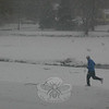 A lone jogger seen in Ram Pasture on February 26 wasn't letting a little snow get in the way of his morning run.  (Hicks photo)