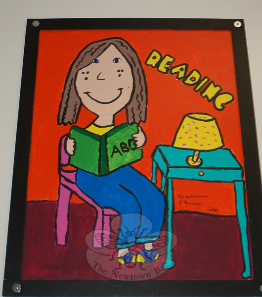 New artwork decorates the hallway outside of Hawley Elementary School's multipurpose room thanks to the work of 25 fourth grade students, who spent their lunch and recess creating 12 posters. The poster to celebrate Reading was created by Hayley Lambert and Alex Watson.  (Hallabeck photo)
