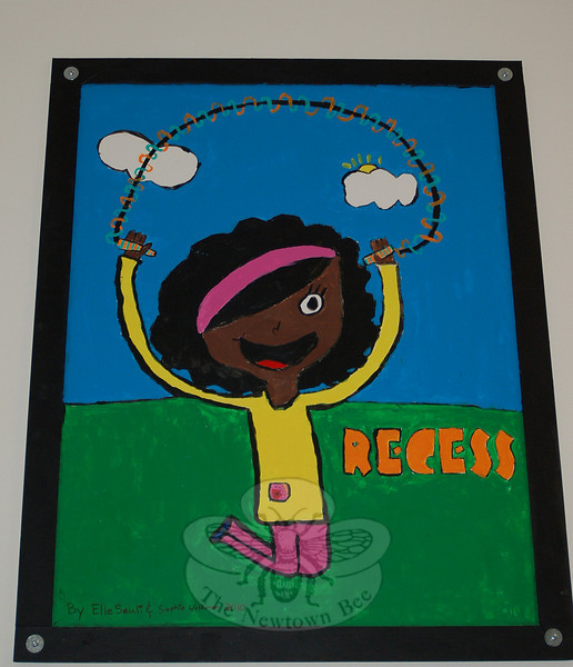 New artwork decorates the hallway outside of Hawley Elementary School's multipurpose room thanks to the work of 25 fourth grade students, who spent their lunch and recess creating 12 posters. Elle Sauli and Sophie Wolfman used their artistic skills to celebrate Recess.  (Hallabeck photo)