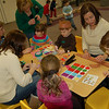 Students and parents at Trinity Day School on Thursday, February 11, worked on creating hats with bear ears for students to wear during the school's Teddy Bear Day, a yearly event at the school when students bring in their favorite bear or stuffed toy friend for the day. Parent volunteers oversee a number of activities, including a bear cave, a sing-along, and creating shoebox seats for the students' stuffed animals.  (Hallabeck photo)