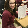 Jenna Calandro holds a letter from her pen pal Ndulu John.  (Hallabeck photo)