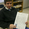 Eighth grader Stephen Walsh received his  Kenyan pen pal letter from Kamene Muoki.  (Hallabeck photo)