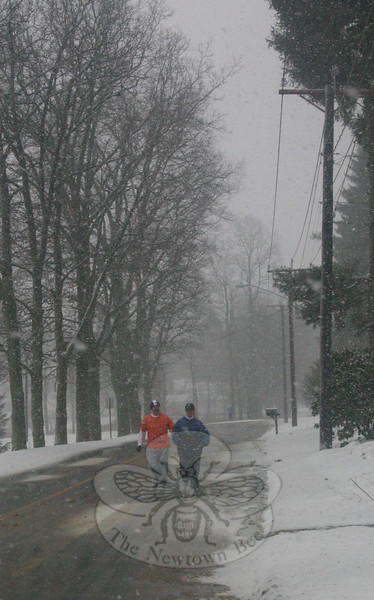 Guy Serra and Carol Franson-Serra weren't going to let the return of snow get in the way of their jog Friday morning.  (Hicks photo)