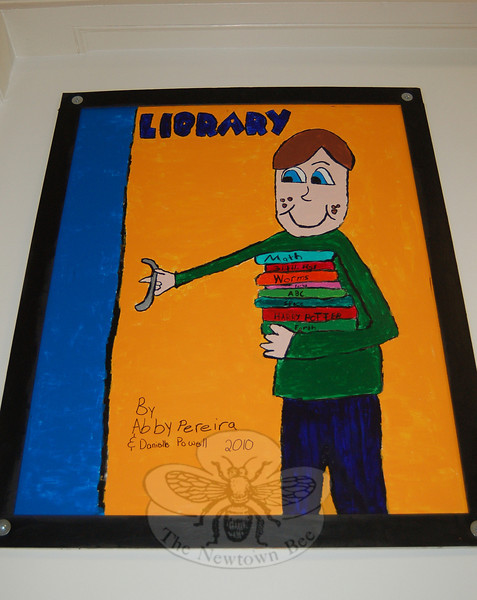 New artwork decorates the hallway outside of Hawley Elementary School's multipurpose room thanks to the work of 25 fourth grade students, who spent their lunch and recess creating 12 posters. Abby Pereira and Danielle Powell did the Library poster.  (Hallabeck photo)