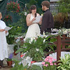 Where shoppers and gardeners usually browse, Tara Jones and Dane Bowman of Danbury chose the site of the pretty greenhouse pond in Lexington Gardens on Church Hill Road for their wedding on Thursday, February 25. Standing on the wooden bridge decorated in tulle and white silk flowers, and surrounded by tropical greenhouse plants, Ms Jones and Mr Bowdan exchanged vows as Eileen Coladarci, Justice of the Peace, officiated at what Lexington Gardens floral manager Arlene McCarthy said was the first wedding to take place at the garden center in many years.  (Crevier photo)
