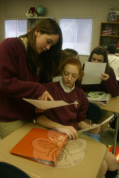 St Rose of Lima eighth grade students Brittany Boggs and Kathryn D'Alessandro share letters from their pen pals in Kenya.  (Hallabeck photo)