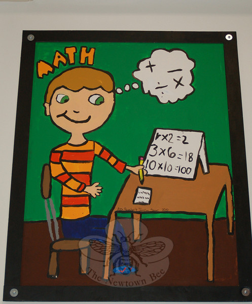New artwork decorates the hallway outside of Hawley Elementary School's multipurpose room thanks to the work of 25 fourth grade students, who spent their lunch and recess creating 12 posters. This poster for Math was done by Allie Paynter and Jessica Stole.  (Hallabeck photo)