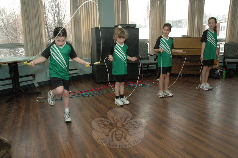 Moon Jumpers memebrs Grace Howgego, Kimberly Johnson, Julia Clark, and Grace Baker lined up to sequentially display their rope jumping skills at a demonstration their group did recently for residents of Masonicare at Newtown and Lockwood Lodge.  (Gorosko photo)