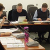 Board of Education Chair Lillian Bittman begins a nearly two-hour presentation of documentation and answers to questions posed by the Board of Finance regarding the school district's 2010-11 budget proposal, while finance board members Martin Gersten, left, and Joseph Kearney listen.  (Voket photo)