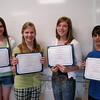 Newtown Middle School students submitted posters to the Connecticut Chapter of The American Statistical Association 2010 Statistical Poster Competition, and recently learned four of the top earners in the state came from NMS. Eighth graders, from left, Kirsten Liniger, who was awarded an honorable mention, Julia Lansing, who took first place in the competition, Anna Northrop, who took third place, and Ryan Nathenson, who took second place, stand together with their award certificates.  (Hallabeck photo)