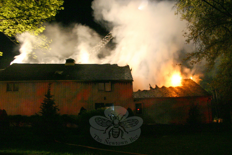 The antique barn at 40 Chestnut Hill Road was heavily damaged by fire Sunday evening. The fire was reported around 8:45 pm May 9, and firefighters were on the scene within minutes, but the building may have been destroyed by the fire.  (Hicks photo)