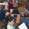 Author Ann Haywood Leal read to Reed Intermediate School students on Monday, May 3, from her book, Also Known As Harper, in the school's library.  (Hallabeck photo)
