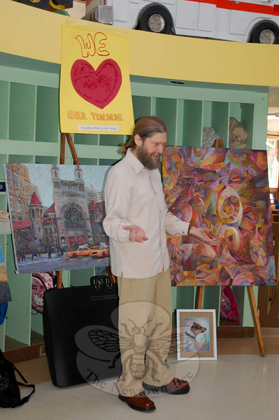 Sandy Hook artist Glen River visited the children at The Children's Adventure Center and showed them some of his artwork on Friday, May 7.  (Crevier photo)