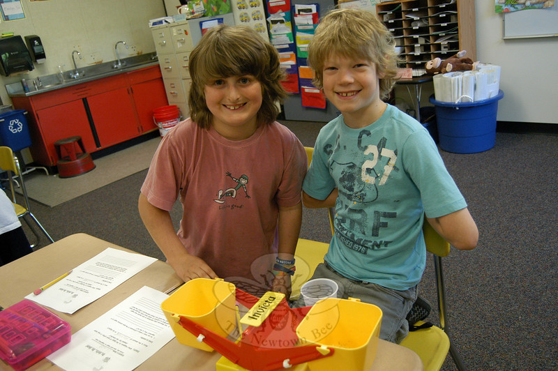 Head O' Meadow third graders Jake Raiani, left, and Colby Delia worked together in Susan Ruddock's classroom to predict, then weigh, whether gum with sugar or gum without sugar would weigh more after chewing during Matter Matters Day on Wednesday, May 5.  (Hallabeck photo)