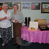 Sisters-in-law Bea Sandone and Mary Lou Graether show off the tea cups they brought to the Newtown Senior Center Mother's Day Bingo and Tea Party, Thursday, May 6.  (Crevier photo)
