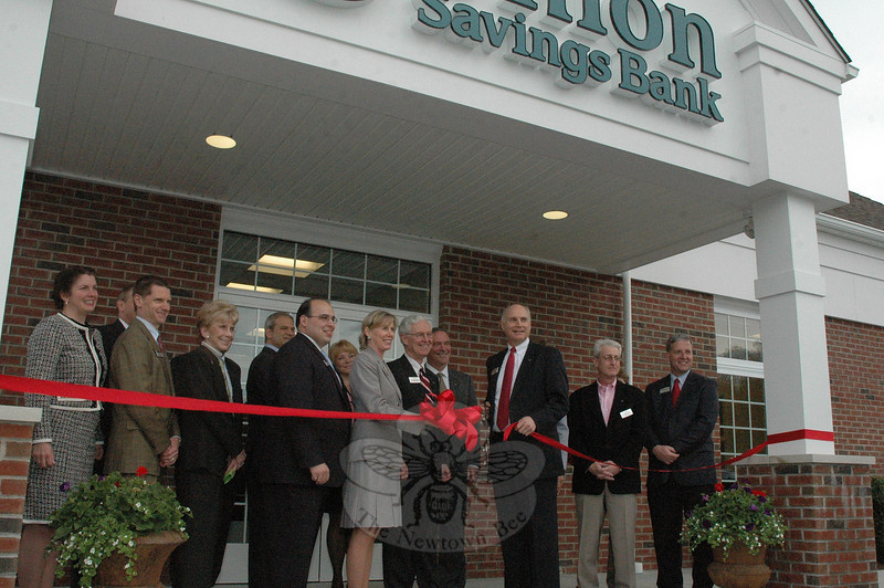 Bank and community representatives cut the ribbon to open the new Union Savings Bank on South Main Street. Pictured, from left, Marie O'Neill, senior vice president, marketing and electronic banking; Chris Daigle, vice president, commercial loan officer; Mary-Pat Cottrell, senior vice president, corporate services; David Zavarelli, assistant branch manager, retail banking officer; Vincent DiGilio, assistant vice president, branch manager; Kerry Gulick, senior mortgage originator; Elizabeth Stocker, AICP, Newtown's director of economic and community development; Thomas Frizzell, president, Union Savings Bank board of trustees; Jay Lent, executive vice president and COO; John Kline, president and CEO; Jeff Levine and Stephen Rosentel, members, Union Savings Bank board of trustees.  (Gorosko photo)