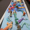 Sculptures of mermaids and shoes created by Newtown Middle School students greeted visitors to the NMS Celebration of the Arts on Tuesday, May 4.  (Hallabeck photo)