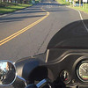 A view over the Harley's windshield and instrument panel on a ride through Fairfield Hills.  (Bobowick photo)