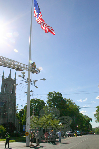 Summer is still just over a month away if you are going by the calendar, but the Lions Club, Hook & Ladder and Keeper of the Flag David Lydem brought summer to the center of Newtown on Saturday, May 15 — Armed Forces Day — with the raising of the summer flag on the Main Street flagpole.  (Hicks photo)