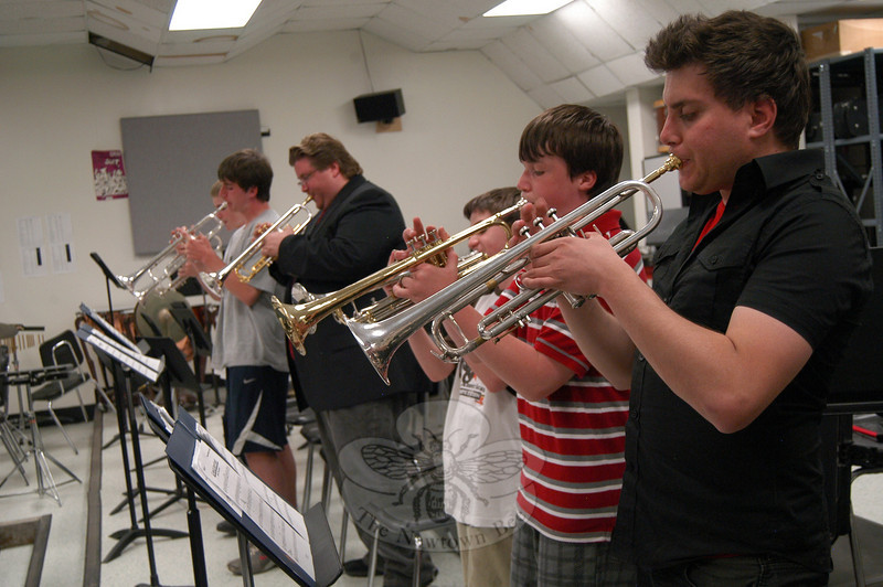 Synergy Brass Quintet jazz ensemble members Greg Lloyd, right, and Bobby Thorp played with members of Newtown Middle School's Jazz Band during a meeting of the NMS group on Monday, May 17.  (Hallabeck photo)