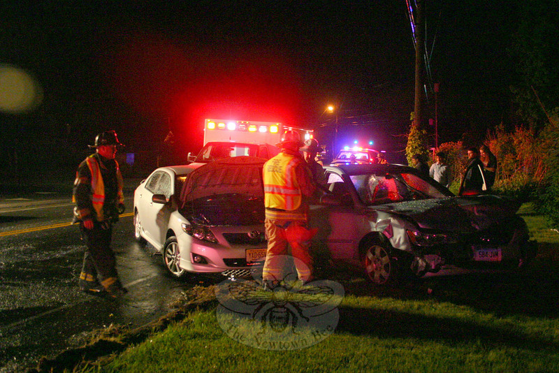 Police report a two-car accident on South Main Street, near its intersection with Blue Spruce Drive, about 8:24 pm May 18. Motorist Tammy Weeden, 48, of Bridgeport was driving a 2008 Hyundai sedan southward on South Main Street, as motorist Raja Perumal, 23, of Karen Drive, who was driving a 2010 Toyota sedan, was attempting to make a left turn out from 320 South Main Street onto northbound South Main Street. As the Toyota attempted to make the turn, the Hyundai sought to avoid hitting the Toyota, but the two vehicles collided. Newtown Volunteer Ambulance Corps members transported Weeden and passenger Sheila Sanders, 40, of Bridgeport to Danbury Hospital for treatment of unknown injuries. Both women were treated and released, a hospital spokeswoman said. Botsford firefighters responded to the accident. Police issued Perumal an infraction for failure to grant the right of way.  (Hicks photo)