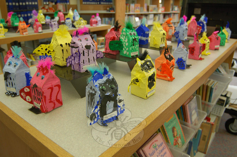 A bright collection of animals that started life as milk cartons was part of the Hawley School Art Night presentation.  (Hallabeck photo)