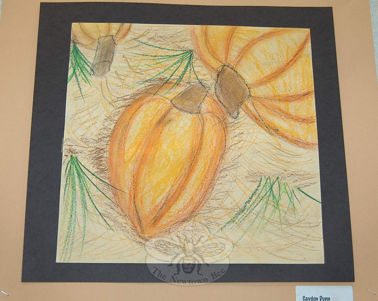Fourth grade students were instructed to draw using some dimensional tricks they had learned, as well as shading and light sources. The result on Art Night was a pumpkin patch, including this drawing by Cayden Dunn.  (Hallabeck photo)