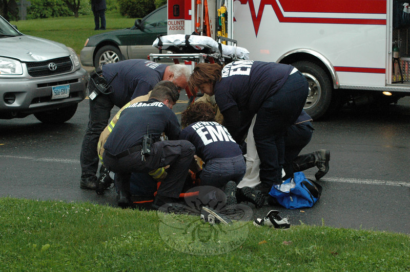 A group of emergency services staffers attended to an injured 17-year-old girl who was struck by a SUV midafternoon on Tuesday as the girl attempted to cross Main Street just south of the flagpole intersection. Police are investigating the accident.  (Gorosko photo)