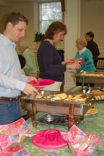 Robert Tarullo, left, and Susan McNulty make their selections from the breakfast buffet prepared for the May 12 Meals On Wheels Volunteer Appreciation Breakfast, by Masonicare at Newtown. (Crevier photo)