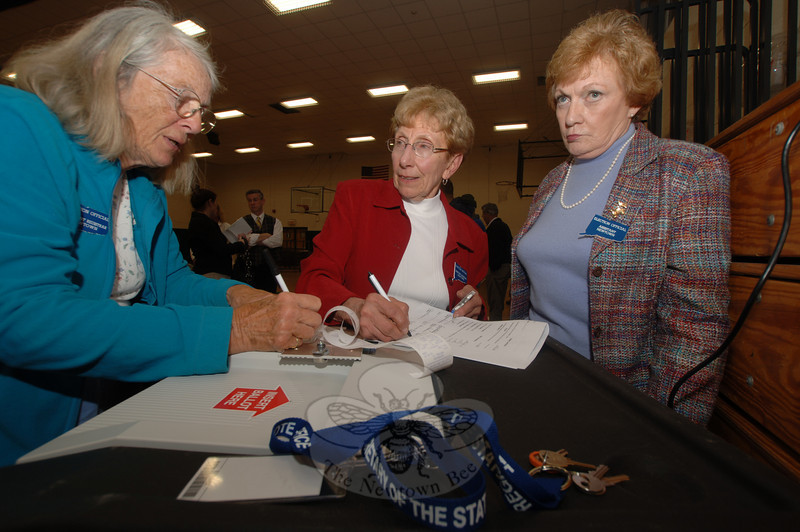 Election officials, from left, April Arnold, Marcia Spiegel and Carol Mattegat read the tape showing the results of Tuesday's budget referendum, which failed by 97 votes.  (Bobowick photo)
