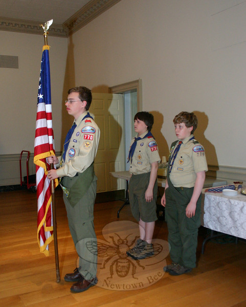 Three members of Newtown Boy Scout Troop 770 served as the color guard to open the National Day of Prayer on May 6. Standing with the flag is Matthew Jensen, who was joined by John Locke, left, and Riley Page.  (Hicks photo)