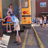 Students at Hawley Elementary school practiced bus evacuation procedures on Friday, May 7. Two students exited the bus first, and helped their fellow students out of the back emergency exit. Michael Macchiarulo, left, and Gordon Walsh, right, help Casey Sullivan out of their bus.  (Hallabeck photo)