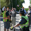 Summer is still just over a month away if you are going by the calendar, but the Lions Club, Hook & Ladder and Keeper of the Flag David Lydem brought summer to the center of Newtown on Saturday, May 15, with the raising of the summer flag on the Main Street flagpole.  (Hicks photo)
