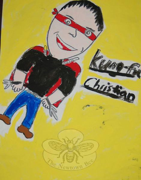 """Kung Fu Christian,"" by Christian Adam, was among the heroes posted on the Sandy Hook School Wall of Fame.  (Hallabeck photo)"