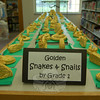 Golden snakes and snails created by Hawley first graders were on view in the school's library for the school's Art Night on Tuesday, May 5.  (Hallabeck photo)