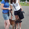 Becca Gillis (left) and Nikki Kaza enjoyed the Strut Your Mutt event with Krissi, a hound dog.