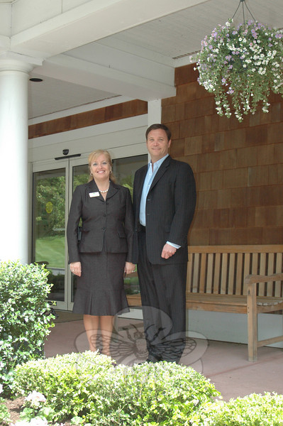 Former Newtown resident Greg Smith, a principal of the newly launched Maplewood at Newtown — formerly The Homesteads — stands near the facility's main entrance with Executive Director Lisa Kinsella.  (Voket photo)