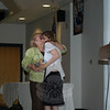 Megan Bernardi, a Newtown High School 2009 graduate, returned to take the Junior-Senior Project course to create a book about her story with autism. Megan thanked her mentor, NHS tutor and job coach Mimi Riccio, at the Monday night culmination event for the course with a gift and hug.  (Hallabeck photo)