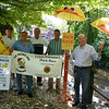 Newtown Lions Club Duck Race Committee members, from left, Paul Arneth, George Arfaras, Tom Evagash, Gordon Williams and Bob Schmidt recently looked back over the first nine years of Duck Races. The group is hoping that Saturday will be sunny for its 10th Annual Great Pootatuck Duck Race, and that Newtown residents will again fill the park at 3-5 Glen Road for a few hours of live entertainment, interaction with community groups and, of course, the race of more than 3,000 rubber ducks along the section of the Pootatuck River seen to the group's right.  (Hicks photo)