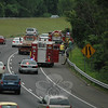 State police and Newtown Hook & Ladder firefighters responded to a gasoline spill about 9:34 am May 24 on westbound Interstate 84, about 1,000 feet west of the Currituck Road overpass. Firefighters worked to contain gasoline that was leaking out from the fuel tank of a disabled pickup truck on the right road shoulder. Hook & Ladder Chief Jason Rivera said that between five gallons and eight gallons of gasoline leaked out of the fuel tank after that tank had hit the ground and was dragged for a distance by the truck. About one gallon of gasoline drained into a stormwater catch basin, he said. A state Department of Environmental Protection spill inspector went to the scene to manage a cleanup of the fuel spilled onto the pavement and into the catch basin. The incident caused travel delays on the highway.  (Gorosko photo)