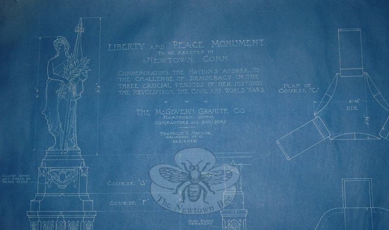 "This detail from the original Frank Naylor blueprint provides the original name of The Liberty and Peace Monument, as well as the purpose of the monument in ""Commemorating the nation's answer to the challenge of democracy in the three crucial periods of her history: the Revolution, the Civil and the World Wars."" The blueprint was returned to the Newtown Historical Society several years ago by descendents of the monument's designer, still in its original mailing tube.  (Clark photo)"