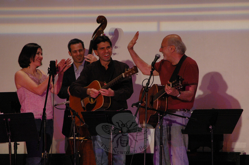 Peter Yarrow (right) congratulates some members of The Radio Café Orchestra who accompanied him following a performance during Saturday's season finale of Flagpole Radio Cafe. From left is Francine Wheeler,  Rick Brodsky and Jim Allyn.  (Gorosko photo)