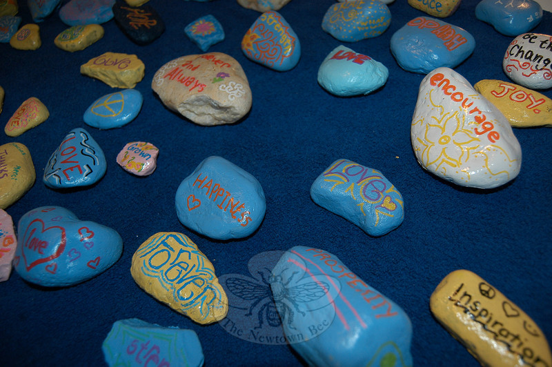 Rocks hand painted by the Two Schools One Song group were sold during the Thursday night event The Blue Z Coffee House to raise funds for a school in Cambodia. (Hallabeck photo)